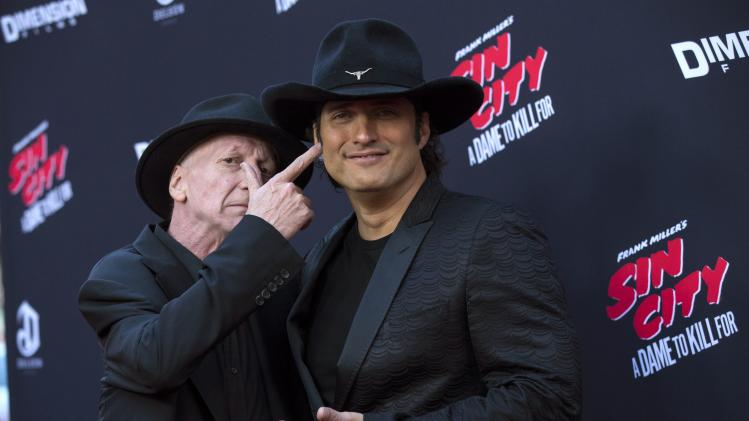 "Writer and director Miller poses with co-director Rodriguez at the premiere of ""Sin City: A Dame to Kill For"" in Hollywood"