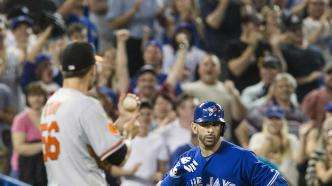 Toronto Blue Jays' Jose Bautista, right, gestures to Baltimore Orioles pitcher Darren O'Day after hitting a home run during the eighth inning of a baseball action in Toronto, Saturday June 22, 2013. (AP Photo/the Canadian Press, Chris Young)