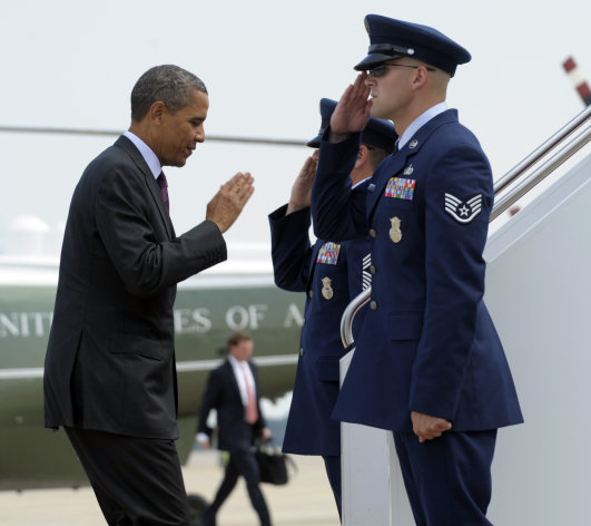 President Barack Obama walks up the steps of Air Force One at Andrews Air Force Base in Md., Monday, July 16, 2012. Obama is heading to Ohio for campaign events. (AP Photo/Susan Walsh)