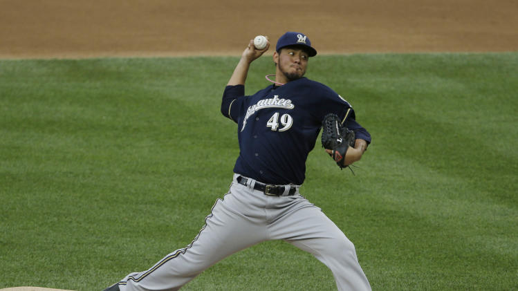 Milwaukee Brewers starting pitcher Yovani Gallardo delivers a pitch against the Washington Nationals during the first inning of a baseball game at Nationals Park, Monday, July 1, 2013, in Washington. (AP Photo/Pablo Martinez Monsivais)