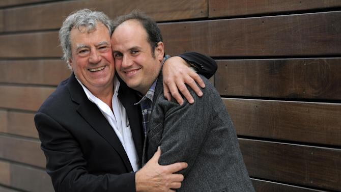 """FILE - In this Sept. 7, 2012 file photo, Bill Jones, right, co-director of the 3-D animated film, """"A Liar's Autobiography - The Untrue Story of Monty Python's Graham Chapman,"""" poses with Monty Python alumnus Terry Jones at the 2012 Toronto Film Festival, in Toronto. Fans will come away with a better sense of the strange inner workings of Chapman, who died of throat cancer in 1989 but is reunited with Cleese and most of his Python mates in the voice cast of """"A Liar's Autobiography,"""" which has a limited U.S. theatrical run starting Friday, Nov. 2, 2012, and has its television premiere the same day on Epix. (Photo by Chris Pizzello/Invision/AP, File)"""