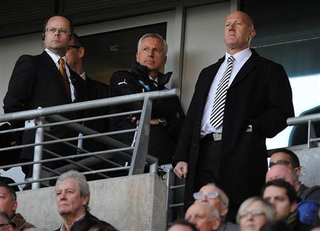 Newcastle United's manager Pardew watches from the stand after being sent off during their English Premier League soccer match against Hull City at the KC Stadium in Hull