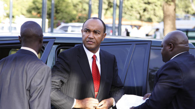 Presidential  candidate Peter Kenneth, center, arrives to take part in a televised debate between presidential contenders, in Nairobi, Kenya Monday, Feb. 11, 2013. Kenya's foreign affairs minister on Monday criticized European Union ambassadors in person for what he called an orchestrated attempt to favor a presidential candidate in Kenya's upcoming elections due to take place on March 4, in which one of the top contenders is Uhuru Kenyatta who faces charges before the International Criminal Court related to the postelection violence that killed more than 1,000 people after Kenya's last presidential election in 2007. (AP Photo/Khalil Senosi) ---------