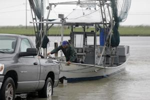 Tony Danos secures a shrimp boat to pull it out of…