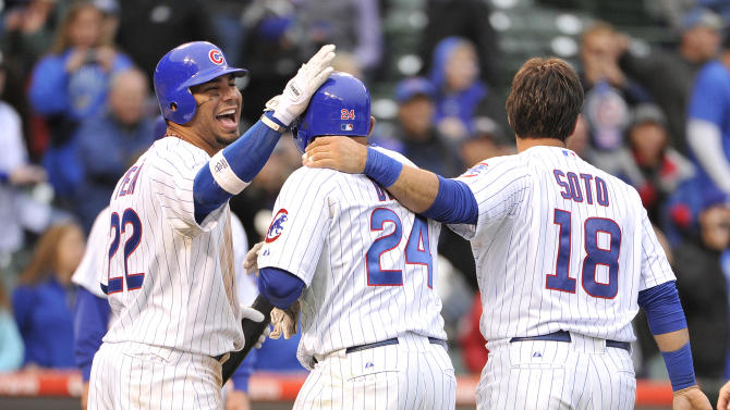 Chicago Cubs' Carlos Pena, left, and Geovany Soto, right, congratulate Marlon Byrd after Byrd hit a game-winning RBI-single scoring Starlin Castro during the 12th inning of a baseball game against the Houston Astros, Friday, Sept. 16, 2011, in Chicago. The Cubs won 4-3 in 12 innings. (AP Photo/Brian Kersey)