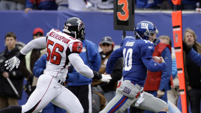 New York Giants quarterback Eli Manning (10) is chased by Atlanta Falcons outside linebacker Sean Weatherspoon (56) during the first half of an NFL wild card playoff football game Sunday, Jan. 8, 2012, in East Rutherford, N.J. (AP Photo/Peter Morgan)