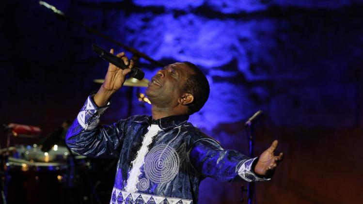 Singer Youssou N'Dour performs during the 50th International Festival of Carthage at the Roman Theatre of Carthage in Tunis