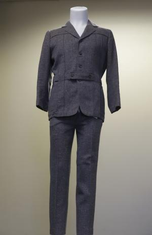 """The grey wool suit Gene Kelly wore in the movie """"Singin' in the Rain"""" is displayed at at Heritage Auctions in Dallas, Monday, Dec. 2, 2013. The once rain-soaked suit is going up for auction after being kept in a closet by a memorabilia collector for more than four decades. (AP Photo/LM Otero)"""