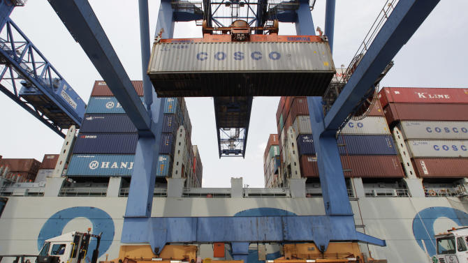 In this Friday, July 13, 2012, photo, a container ship from China is offloaded at Massport's Conley Terminal in the port of Boston. U.S. trade deficit grew to $42 billion in July, widened by fewer exports to Europe, India and Brazil that offset a steep decline in oil imports.  (AP Photo/Stephan Savoia)