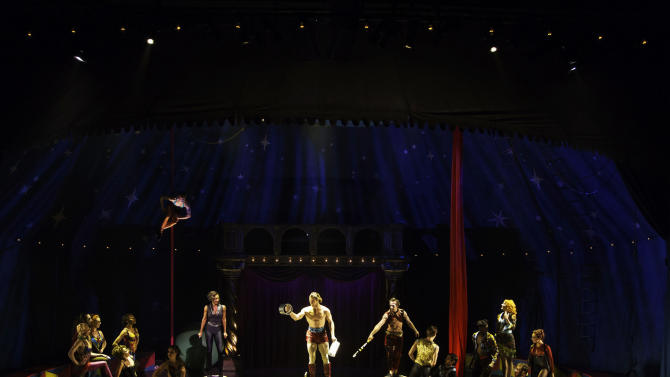 """This undated publicity photo provided by American Repertory Theater shows, center, Orion Griffiths and the Pippin company, in a production of """"Pippin,"""" at the American Repertory Theater in Cambridge, Mass. (AP Photo/ American Repertory Theater, Michael J. Lutch)"""