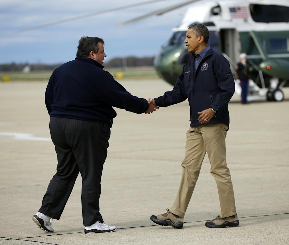 FILE - In this Oct. 31, 2012 file photo, President Barack Obama is greeted by New Jersey Gov. Chris Christie upon his arrival at Atlantic City International Airport in Atlantic City. With humor and candor, Christie has been addressing a political vulnerability: his weight. (AP Photo/Pablo Martinez Monsivais, File)