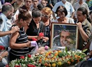 Ofelia Acevedo (L) widow of opposition leader Oswaldo Paya and their daughter Rosa Maria Paya (2ndL) attend his funeral, on July 24, at Cristobal Colon cemetery in Havana. Acevedo rejected Saturday a government report that blamed the car crash that killed her husband and a fellow dissident on the vehicle's driver