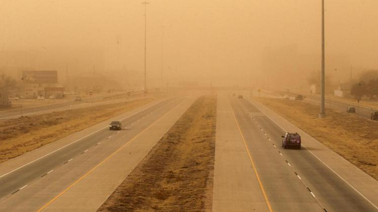 Cars navigate along the Marsha Sharp Freeway during a dust storm in Lubbock, Texas, Wednesday, Dec. 19, 2012.(AP Photo/Lubbock Avalanche-Journal, Zach Long) ALL LOCAL TV OUT