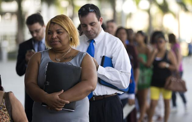 In this Jan. 15, 2013, photo, Racheel Weston, stood in line with a few hundred other job seekers, during the job fair that the Miami Marlins hosted at Marlins Park in Miami. The number of Americans se