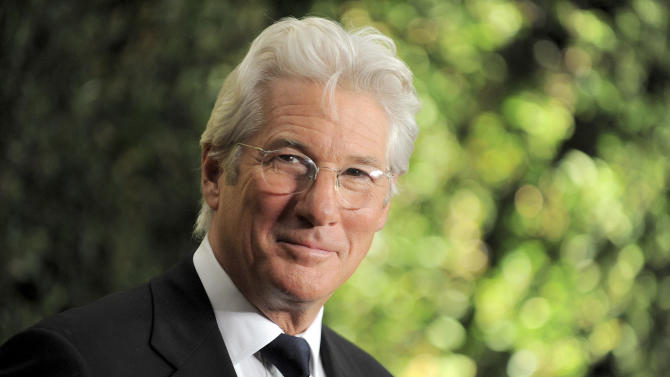 Richard Gere arrives at the 4th Annual Governors Awards at Hollywood and Highland Center's Ray Dolby Ballroom on Saturday, Dec. 1, 2012, in Los Angeles. (Photo by Jordan Strauss/Invision/AP)