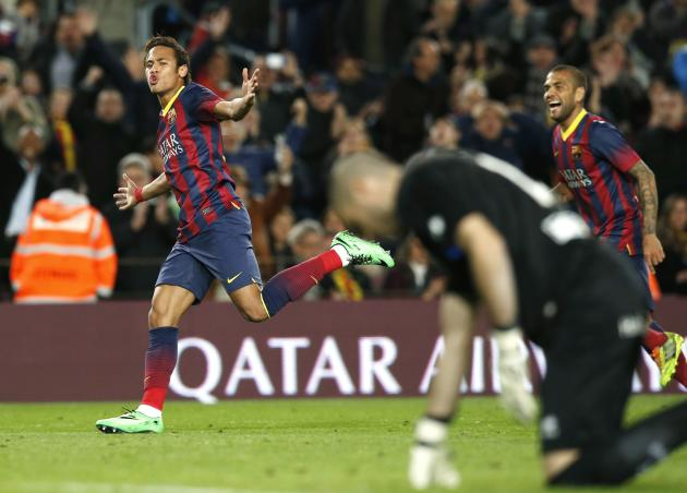 Barcelona's Neymar and Dani Alves celebrate a goal against Rayo Vallecano's goalkeeper Ruben during their Spanish first division soccer match in Barcelona