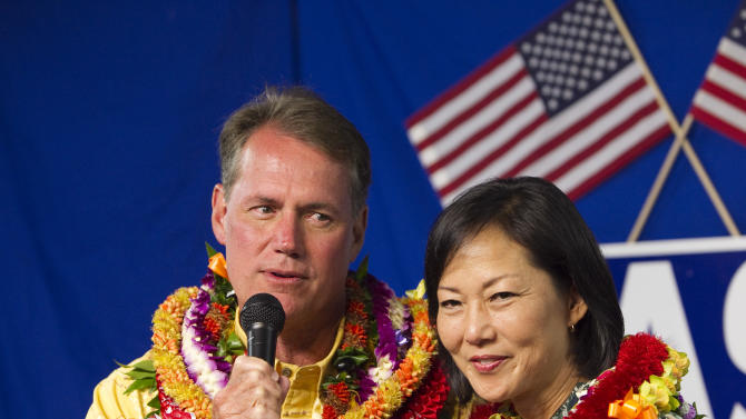 Hawaii politician Ed Case, left, and his wife, Audrey Case speak to supporters at his campaign headquarters Saturday, Aug. 11, 2012 in Honolulu.  Case is running for the Democratic nomination for a Hawaii seat in the U.S. Senate. Saturday's contest is the first since 1976 without an incumbent running, and whoever wins will become just the sixth senator in the state's 53-year history, replacing retiring Democratic Sen. Daniel Akaka.     (AP Photo/Marco Garcia)