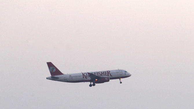 A Kingfisher Airlines flight approaches the Indira Gandhi International airport in New Delhi, India, Friday, Nov. 11, 2011. Kingfisher, which is partly owned by brewery tycoon Vijay Mallya, has canceled more than 120 flights this week as pilots and crew called in sick after their October salaries were delayed. (AP Photo/ Gurinder Osan)