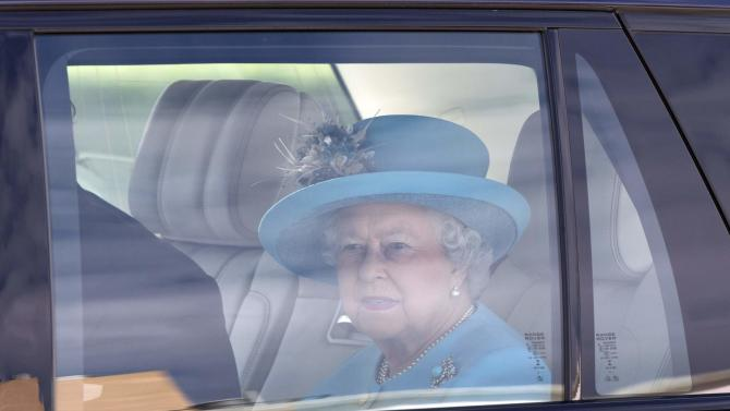 Britain's Queen Elizabeth arrives for a visit to Malta Racing Club at Marsa racecourse near Valletta