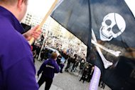 Supporters of the web site &#39;The Pirate Bay&#39;, one of the world&#39;s top illegal filesharing websites, demonstrate in 2009. An 18-year-old Slovak is facing up to five years behind bars for posting links sharing pirated movie downloads on the Internet, police in the capital Bratislava said in a statement Friday