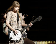 Taylor Swift performs onstage during the 54th annual Grammy Awards on Sunday, Feb. 12, 2012 in Los Angeles. (AP Photo/Matt Sayles)