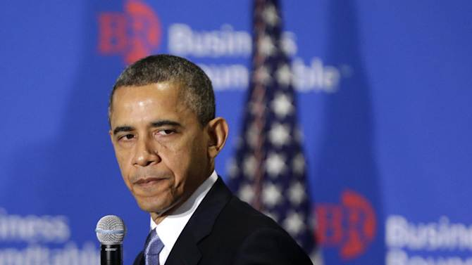 """FILE - This Dec. 5, 2012 file photo shows President Barack Obama pauses as he speaks about the fiscal cliff at the Business Roundtable, an association of chief executive officers, in Washington. Some of the best Republican arguments against President Barack Obama's proposals to avoid a """"fiscal cliff"""" come from the president himself.  (AP Photo/Charles Dharapak, File)"""