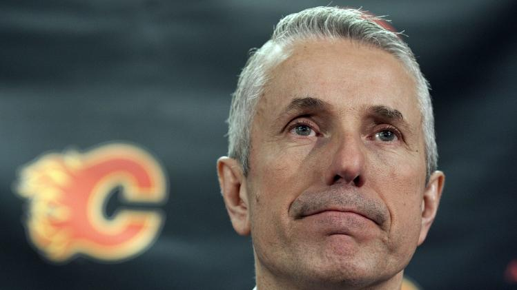 Calgary Flames head coach Bob Hartley speaks to the media following his team's game in Calgary, Alberta, Wednesday, March 27, 2013. The Calgary Flames Hockey Club have traded team captain Jarome Iginla in exchange for forwards Kenneth Agostino and Ben Hanowski and the Pittsburgh Penguins 2013 first round pick. (AP Photo/The Canadian Press, Jeff McIntosh)