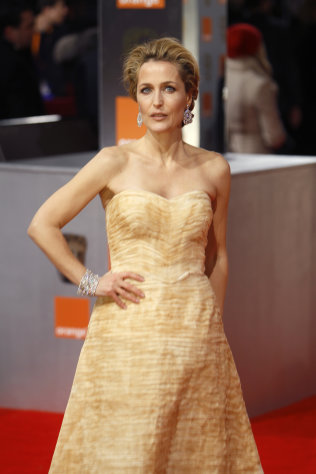 Actress Gillian Anderson arrives for the BAFTA Film Awards 2012, at The Royal Opera House in London, Sunday, Feb. 12, 2012. (AP Photo/Alastair Grant)