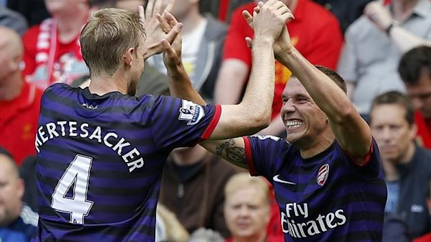 Arsenal's Lukas Podolski (R) celebrates his goal against Liverpool with Per Mertesacker
