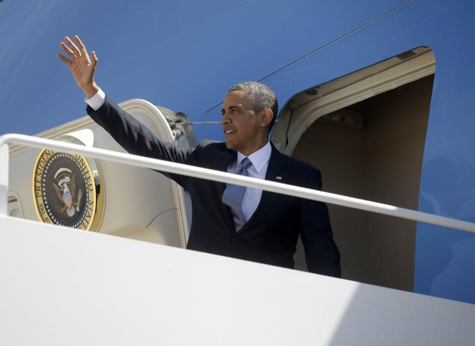 President Barack Obama waves as he boards Air Force One before his departure from Andrews Air Force Base, Md., Thursday, May 2, 2013. Obama is traveling on a three-day trip to Mexico and Costa Rica. (AP Photo/Pablo Martinez Monsivais)