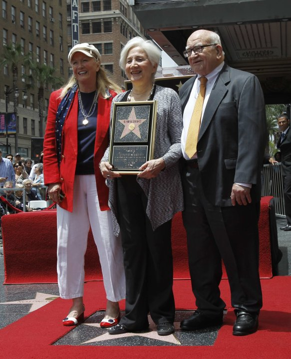 Dukakis, with Ladd and Asner, stands on her star after it was unveiled on the Walk of Fame in Los Angeles