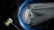 This artist's impression shows NASA's Cassini spacecraft exploring the magnetic environment of Saturn. Saturn's magnetosphere is depicted in grey, while the complex bow shock region — the shock wave in the solar wind that surrounds the magnetos