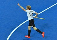Germany's Jan Philipp Rabente reacts after scoring against The Netherlands during their men's field hockey gold medal match at the London 2012 Olympic Games. Germany won the gold