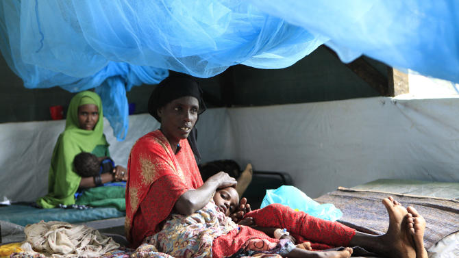 "Somali women soothe their children, who are receiving treatment for malnutrition, at a Doctors Without Borders hospital in Dagahaley Camp, outside Dadaab, Kenya, Monday, July 11, 2011. U.N. refugee chief Antonio Guterres said Sunday that drought-ridden Somalia is the ""worst humanitarian disaster"" in the world, after meeting with refugees who endured unspeakable hardship to reach the world's largest refugee camp in Dadaab, Kenya. (AP Photo/Rebecca Blackwell)"