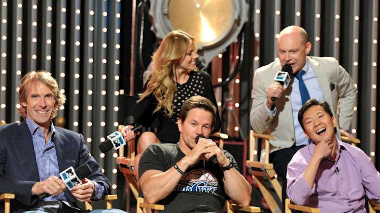 """Members from the cast and crew of  """"Pain & Gain"""" from left, director Michael Bay actors Mark Wahlberg, Ken Jeong, background right, Rob Corddry, and Bar Pal  are seen at """"The MTV Movie Awards Sneak Peek Week"""" on Tuesday, April 9, 2013 in Universal City, Calif. (Photo by John Shearer/Invision for MTV/AP Images)"""