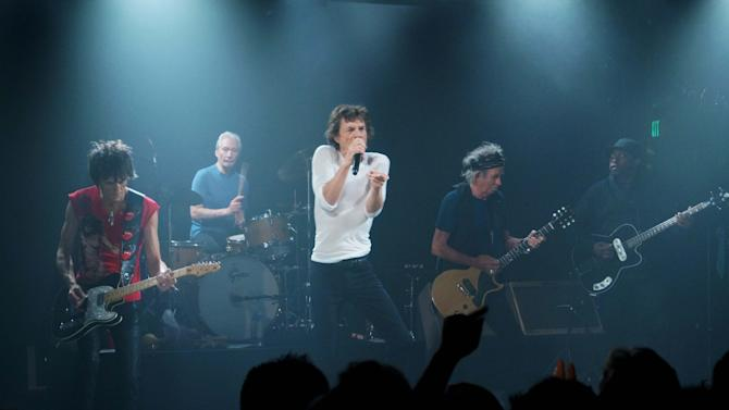 "This Saturday, April 27, 2013 photo provided by The Rolling Stones shows the group performing during a surprise gig at the Echoplex in Los Angeles. The legendary group rocked a small club in Los Angeles on Saturday night for a minuscule crowd compared to the thousands set to see them launch their ""50 and Counting"" anniversary tour a week later on May 3 at the Staples Center. (AP Photo/The Rolling Stones, Luis Soto)"