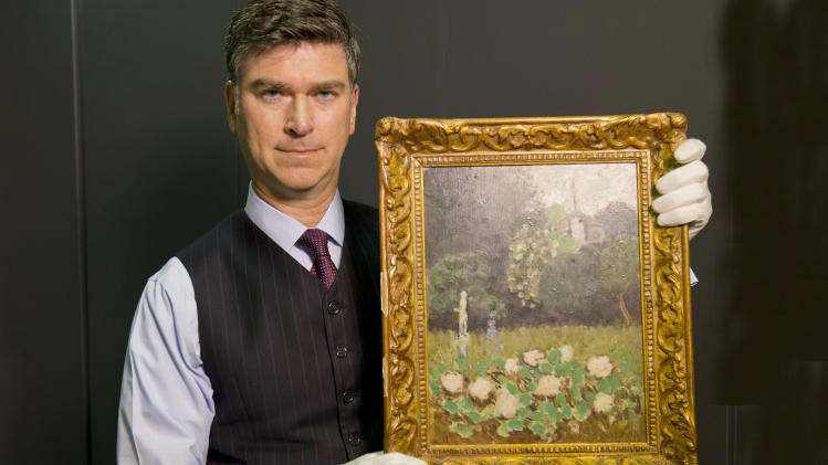 "In this undated image released by The Art Loss Register, Christopher Marinello, Executive Director & General Council of The Art Loss Register, holds a Henri Matisse painting, ""Le Jardin"" 1920. Le Jardin, or The Garden, was taken from the Museum of Modern Art in Stockholm during a robbery on May 11, 1987 and has been found by an art recovery specialist in London. (AP Photo/Jeremy Young, HO)"