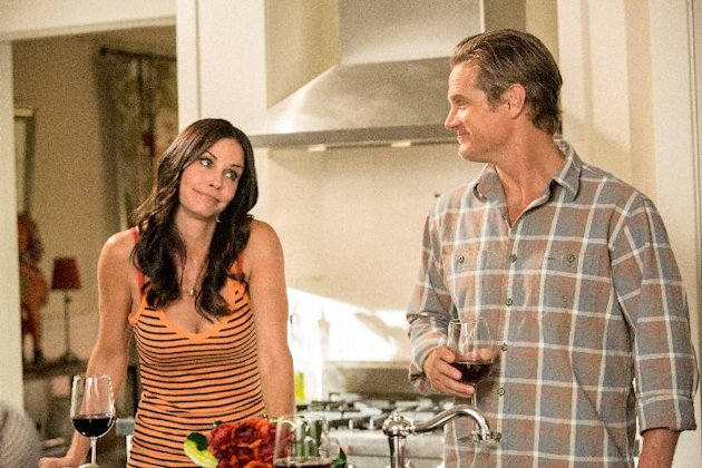 This undated image released by TBS shows Courteney Cox, left, and Brian Van Holt in a scene from the fourth season of &quot;Cougar Town,&quot; premiering Tuesday, Jan. 8, 2013 at 10p.m. EST on TBS. (AP Photo/TBS, Danny Feld)