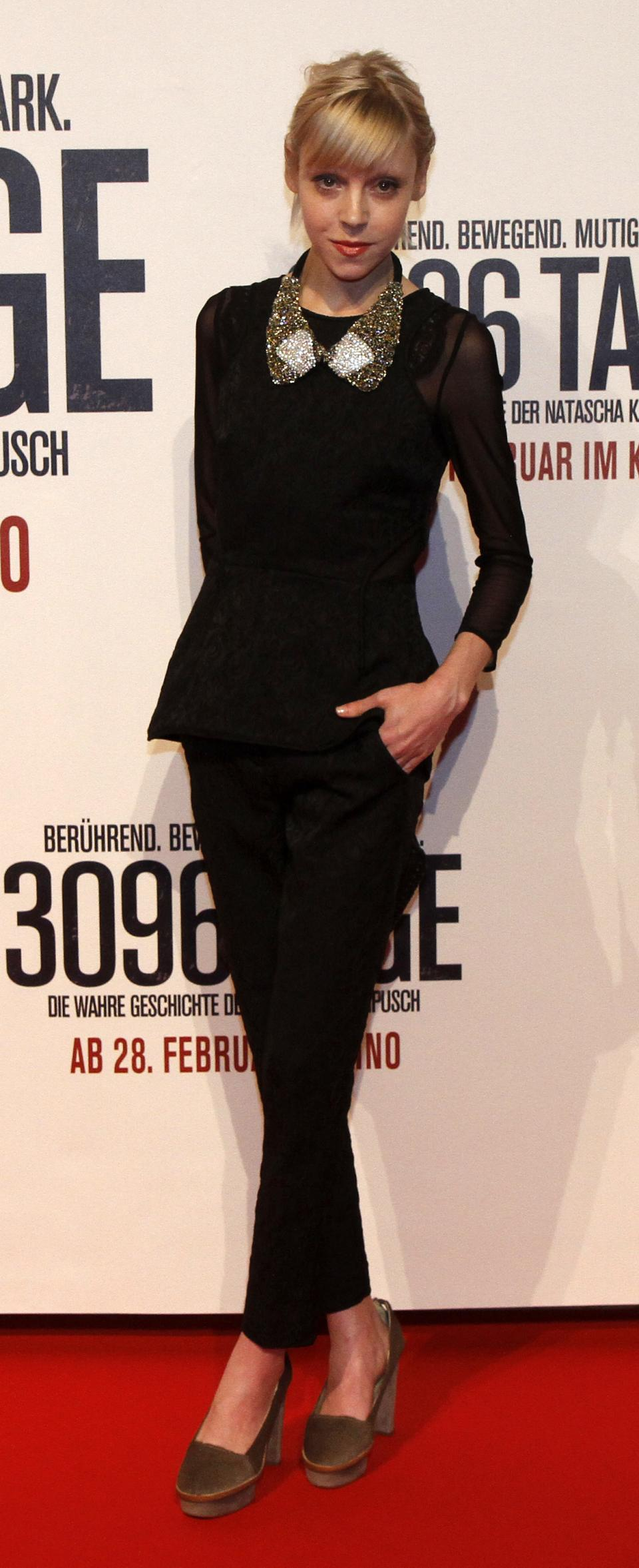 "British actress Antonia Campbell-Hughes poses for photographers before the premiere of the film ""3096 Days"" in Vienna, Austria, Monday Feb. 25, 2013.  The film tells the story of Kampusch who was abducted as a schoolgirl and held prisoner in a cellar for almost nine years. (AP Photo/Ronald Zak)"