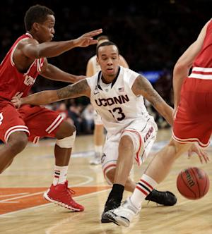 No. 18 Connecticut holds off Indiana 59-58