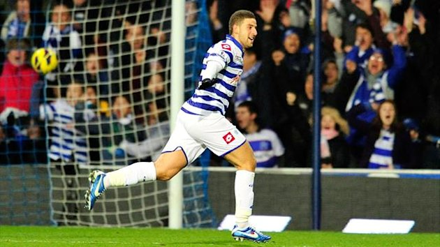 Queens Park Rangers' Moroccan midfielder Adel Taarabt celebrates scoring during the English Premier League football match between Queens Park Rangers and Fulham at Loftus Road (AFP)