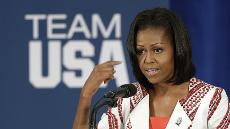 First lady Michelle Obama speaks during a breakfast with Team USA at the 2012 Summer Olympics, Friday, July 27, 2012, in London. (AP Photo/Darron Cummings)