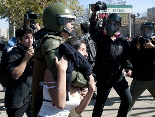 A student is arrested by Chilean riot police during a protest in Santiago, on August 8. Authorities arrested 75 people after police used tear gas and water cannons to crack down on student protesters in the capital who torched three city buses, injuring 49 police, the mayor's office said.