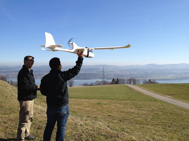 In this March 15, 2012 photo released by ConservationDrones.org., conservation drone pioneer Lian Pin Koh, right, of the Swiss Federal Institute of Technology, and partner Serge Wich conduct a drone t