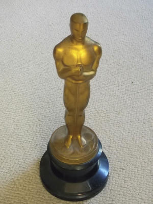 """This undated photo released by Briarbrook Auctions shows an Academy Award Oscar statue awarded for color art direction in 1942 to Joseph C. Wright for his work on """"My Gal Sal."""" The statuette is being auctioned in Rhode Island Monday evening, June 23, 2014, by Wright's nephew. Wright died in 1985. The Academy of Motion Picture Arts and Sciences does not allow an Oscar statuette to be sold without first offering it back to the academy for $1. But the auction house said that restriction does not apply to awards before 1950. (AP Photo/Briarbrook Auctions)"""