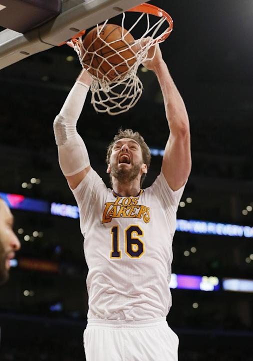 Los Angeles Lakers center Pau Gasol dunks the ball against the Oklahoma City Thunder during the second half of an NBA basketball game in Los Angeles, Sunday, March 9, 2014. The Lakers won 114-110