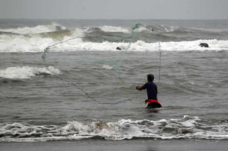 A fisherman casts his net into the waters of Chachalaca Beach, in the gulf coast state of Veracruz, Mexico, Saturday Sept. 10, 2011. Tropical Storm Nate is headed west, threatening new areas of Mexico's gulf coast where hurricane conditions are expected by early Sunday afternoon. (AP Photo/Eduardo Verdugo)