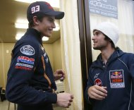 Honda MotoGP rider Marc Marquez (L) of Spain chats with KTM Moto3 rider Arthur Sissis of Australia in the paddock area ahead of Sunday's Japanese Grand Prix in Motegi, north of Tokyo October 25, 2013. All Friday practices were cancelled due to weather, organizer said. REUTERS/Toru Hanai (JAPAN - Tags: SPORT MOTORSPORT)