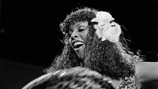 """FILE - In this Aug. 11, 1979 file photo, singer Donna Summer swings the skirt of her leopard-print dress during her concert at the Universal Amphitheater in Los Angeles, Calif. Summer, the Queen of Disco who ruled the dance floors with anthems like """"Last Dance,"""" """"Love to Love You Baby"""" and """"Bad Girl,"""" has died. Her family announced her death in a statement Thursday, May 17, 2012.  She was 63. (AP Photo/File)"""