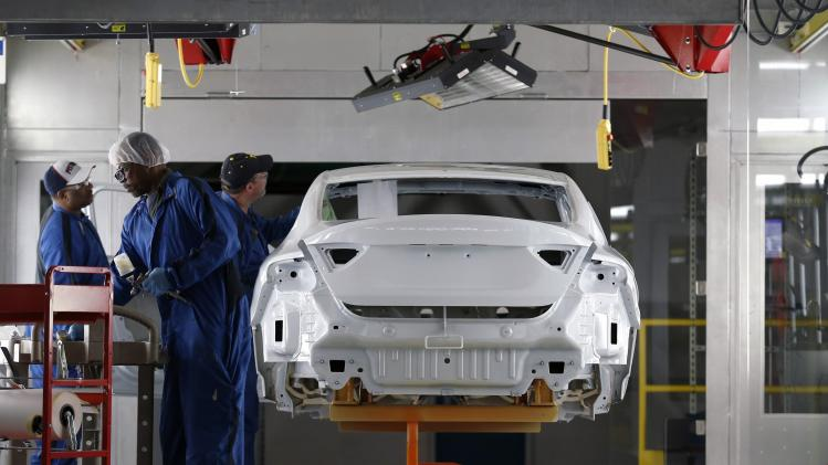 A Chrysler assembly worker spot paints the body of a 2015 Chrysler 200 vehicle at the Sterling Heights Assembly Plant in Michigan